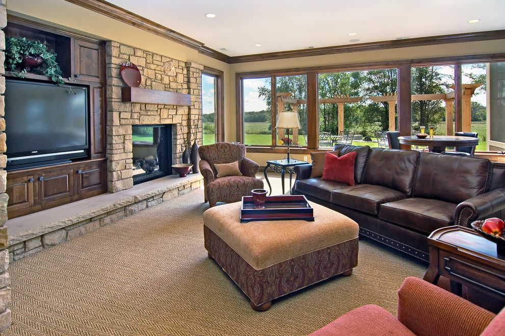 Lowes Carpet Cleaner with Traditional Family Room Also Ceiling Lighting Crown Molding Fireplace Hearth Leather Sofa Media Storage Paisley Armchair Paisley Fabric Recessed Lighting Stone Fireplace Surround Tan Carpet Wood Trim