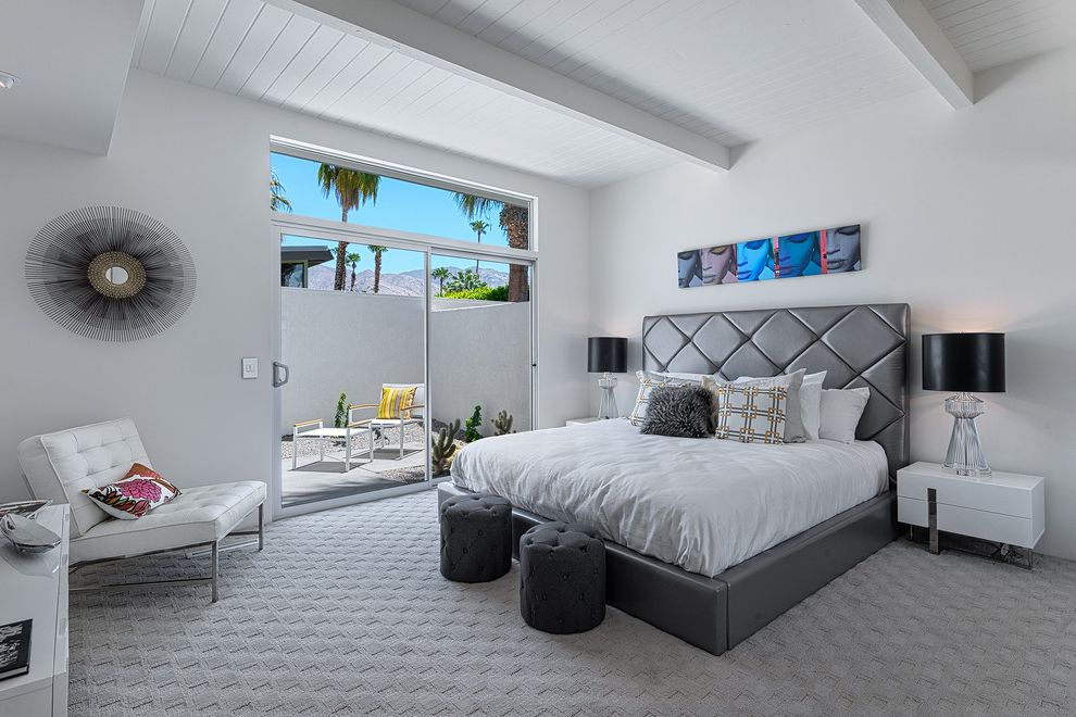Lowes Carpet Sale   Midcentury Bedroom  and Clerestory Window Gray Bed Gray Carpet Sliding Glass Door Tongue and Groove Ceiling Transom Window Upholstered Bed White Lounge Chair White Nightstand