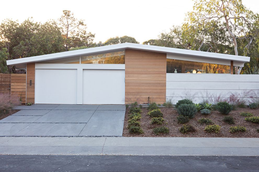 Lowes Cedar Rapids with Midcentury Exterior  and Clerestory Windows Curb Appeal Eichler Home Inside Outside Light Low Pitch Gable Roof Mid Century Modern Sofa Modern Open Floor Plan Open to Nature Residential Two Garage Doors
