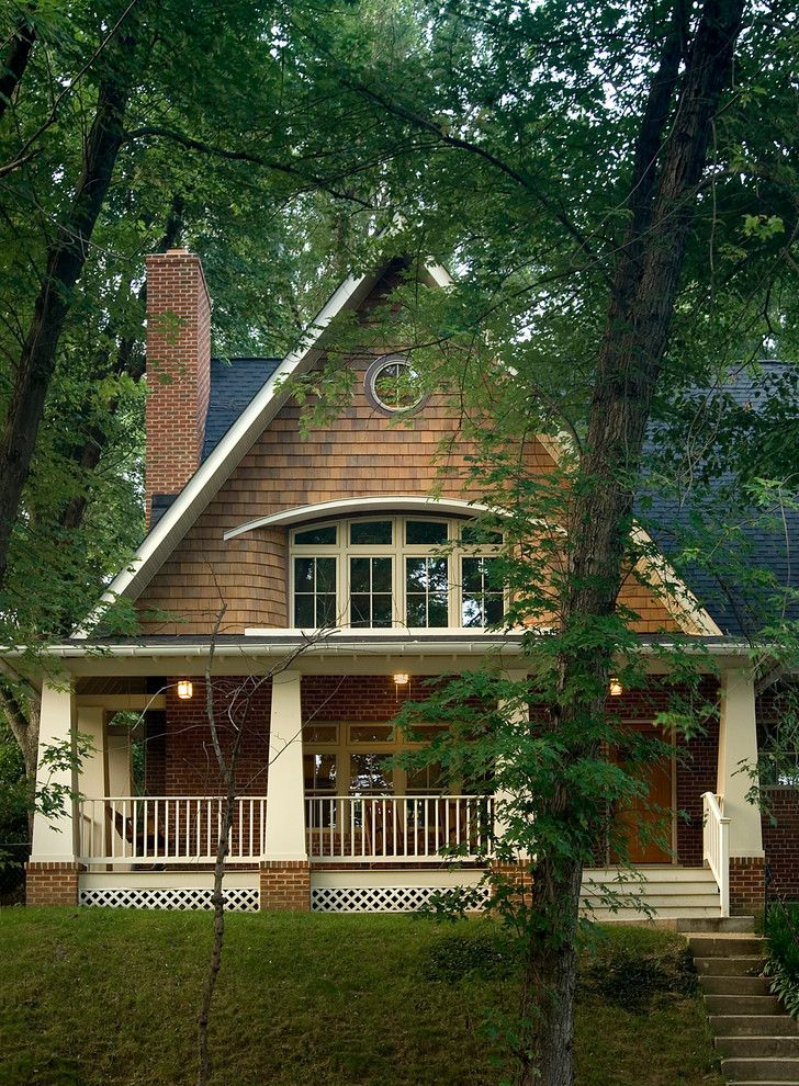 Lowes Cedar Rapids with Traditional Exterior  and Arts Crafts Arts and Crafts Brick Brick Chimney Cedar Siding Column Details Pitched Roof Pop Up Porch Rafter Railing Roof Round Window Second Floor Addition Shingles Stairs Transom