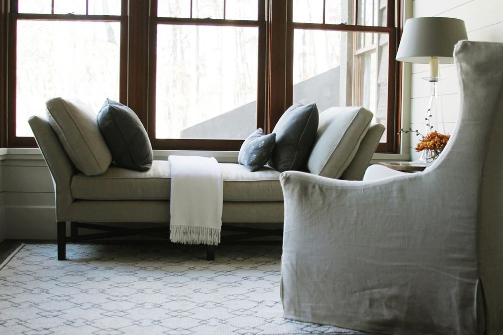 Lowes Clearwater   Beach Style Living Room  and Area Rug Day Bed Decorative Pillows Double Hung Windows Monochromatic Neutral Colors Slipcovers Throw Pillows