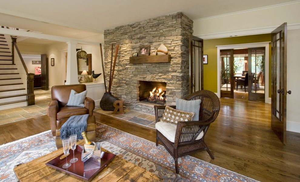 Lowes Clearwater   Craftsman Living Room  and Area Rug Crown Molding Earth Tone Colors Fireplace Mantel Interior Doors Leather Armchair Pillars Stone Fireplace Surround White Wood Wood Flooring Wood Molding