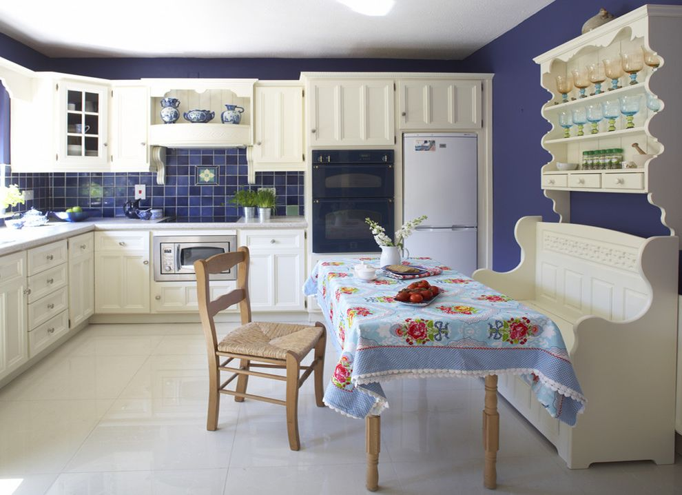 Lowes Dublin   Contemporary Kitchen Also Banquette Blue Blue Tile Backsplash Cottage Kitchen Country Kitchen Dark Blue Walls Eat in Kitchen Floral Tablecloth Kitchen Kitchen Table Rush Seat Chair Wall Hutch White Kitchen