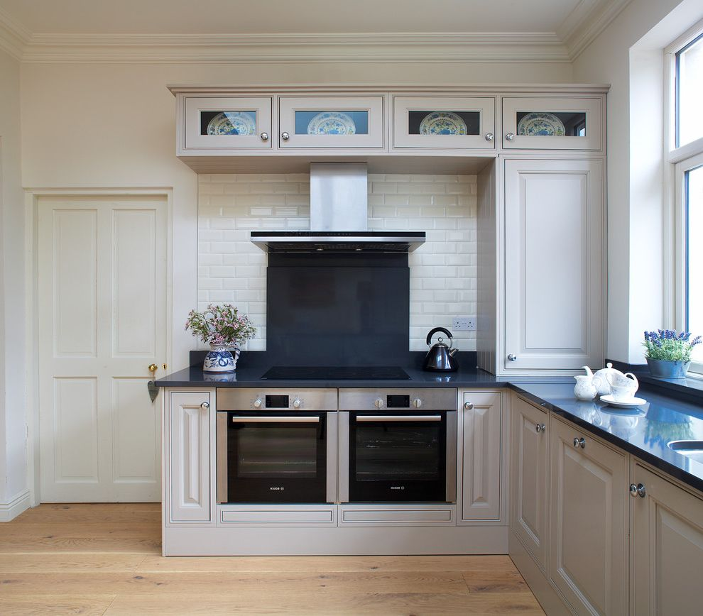 Lowes Dublin   Traditional Kitchen  and Black Counters Extractor Fan Over Glass Upper Cabinets Hood Kitchen Large Windows Raised Panel Door Subway Tile White Walls Wood Floor