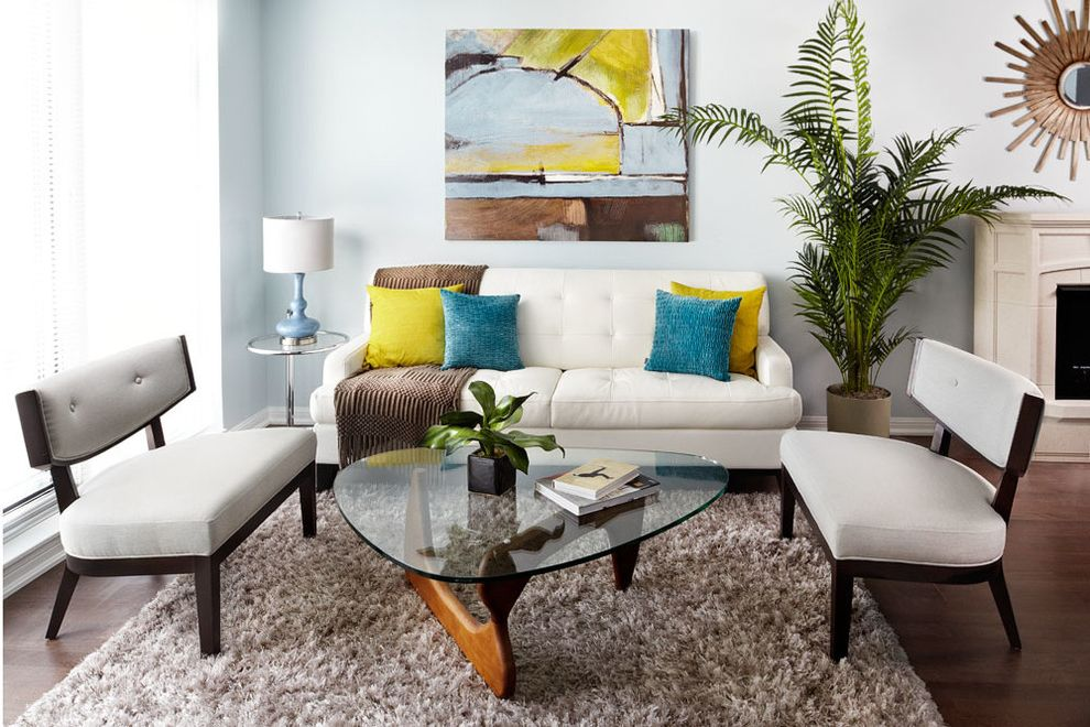 Lowes Enterprise Al   Eclectic Living Room  and Apartment Armchair Art Coffee Table Condo Dark Wood Floor Fireplace Glass Coffee Table Mirror Mirror Above Fireplace Plant Rug Side Table White Sofa Wood Floor