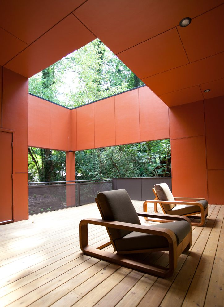 Lowes Enterprise Al   Modern Porch  and Atlanta Cablik Colorful Covered Patio Deck Minimal Modern Home Orange Walls Outdoor Cushions Outdoor Lighting Panel Siding Patio Patio Furniture