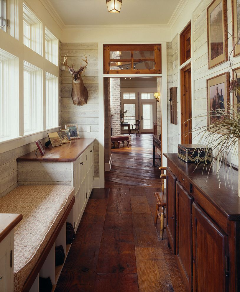 Lowes Flooring Sale with Farmhouse Hall  and Built in Bench Cubbies Dark Wood Floor Deer Head Mud Room Storage Transom Whitewashed Wood Wall Window Seat Wood Wall Yellow