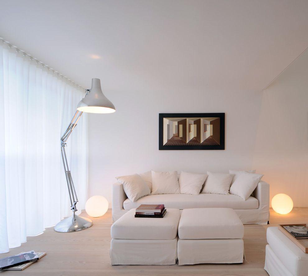 Lowes Flooring Sale with Scandinavian Living Room Also Chrome Floor Lamp Glo Ball Glow Ball Oversize Floor Lamp Wall Art White Curtains White Living Room White Ottoman White Sofa