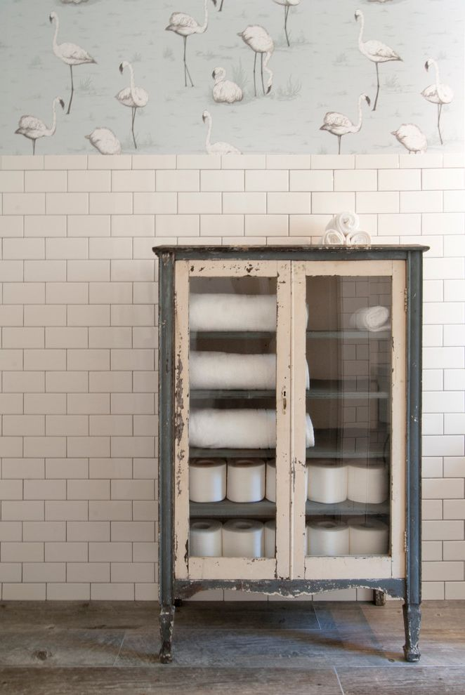 Lowes Fremont Ohio with Eclectic Bathroom  and 3x6 Subway Tile Bathroom Cabinet Ceramic Tile Floor Dark Grout Industrial Cabinet Small Sink Subway Tiles Tile Wainscoting Towel Cabinet Vintage Cabinet Wallpaper White Countertop
