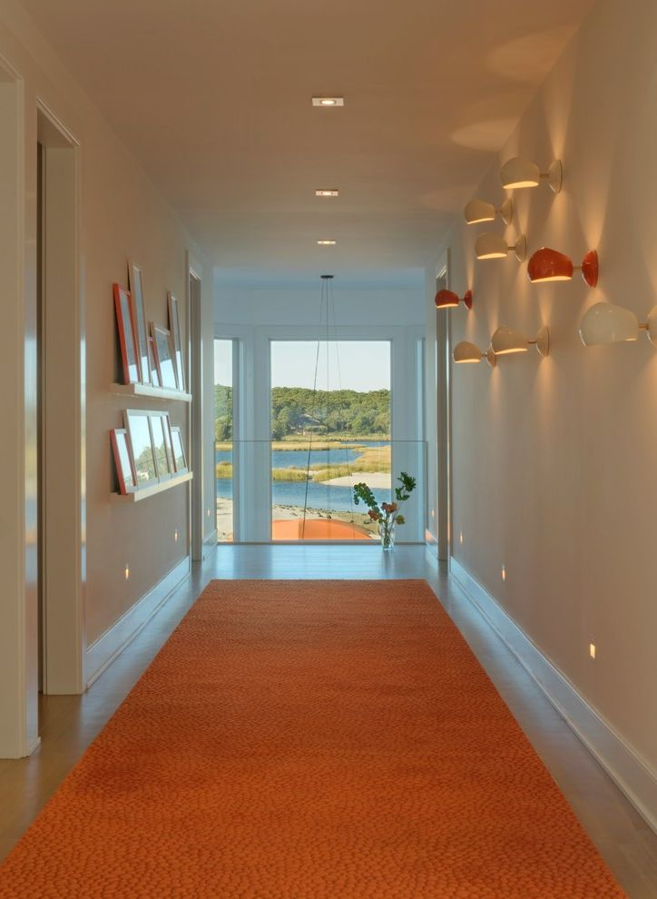 Lowes Hampton Va with Beach Style Hall  and Baseboard Beach Carpet Runner Floating Shelves Framed Prints Glass Panel Railing Hallway Hallway Lights Ledge Orange Recessed Lights View Wall Sconce Water White Casing White Walls
