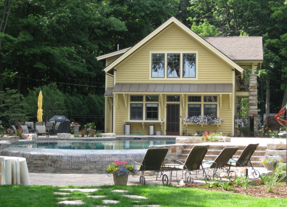 Lowes Holland Mi   Traditional Exterior  and Beautiful Pool Cottage Infinity Edge Infinity Pool Landscape Lawn Overhang Patio Pool Pool House Stepping Stones Stone Stone Step Swimming Pool Yellow Yellow Exterior