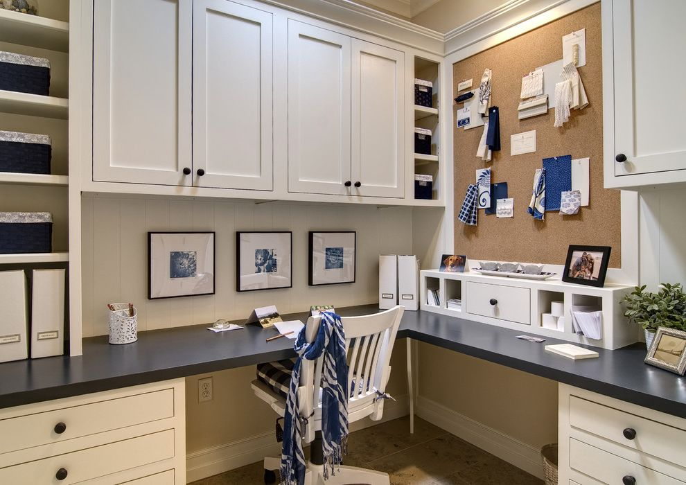 Lowe's Home Improvement Corporate Office with Traditional Home Office  and Built in Cabinetry Built Ins Built in Desk Bulletin Board Cork Cork Board Corner Desk Cubbies Desk Chair Home Office Navy Office Office Space Organization Organize Office
