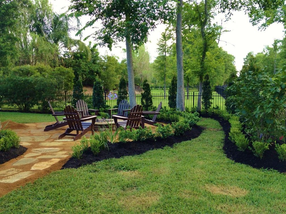 Lowes Kingwood with Traditional Patio Also Adirondack Chairs Black Fence Black Mulch Circular Curved Fire Pit Garden Grass Hedges Pavers Plants Sitting Area Trees