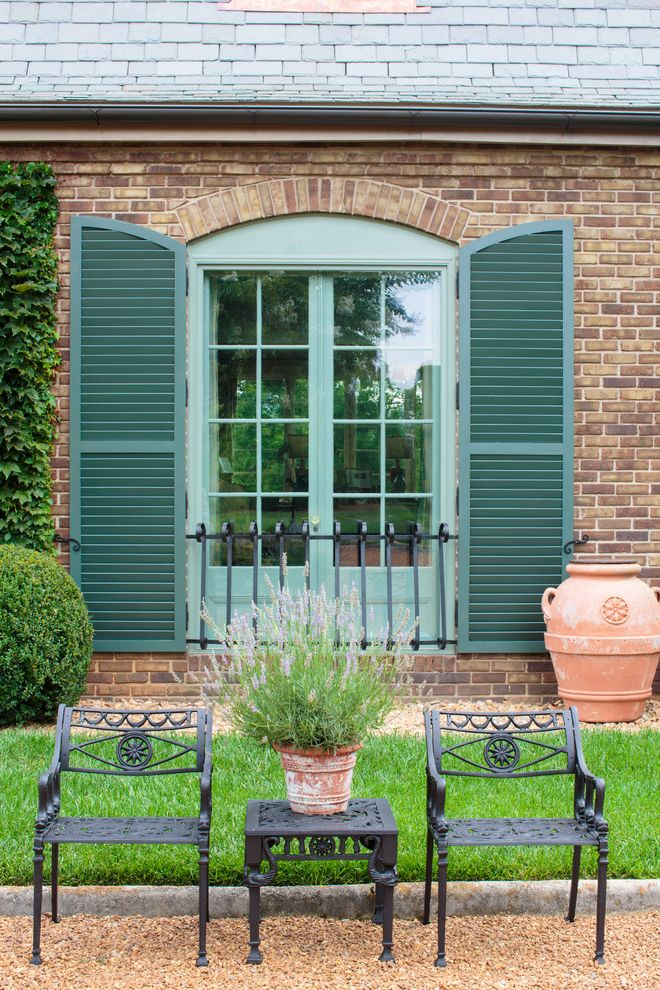 Lowes Knoxville Tn with Mediterranean Patio  and Black Metal Patio Chairs Brick Exterior Brick House Brick Wall Gravel Green Shutters Lavender Low Windows Terra Cotta Pot Window Railing Wrought Iron Patio Chairs