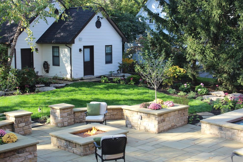 Lowes Mansfield Ohio   Traditional Patio  and Backyard Shed Equipment Room Equipment Shed Garden Shed Hardscape Outdoor Storage Paved Patio Pink Flowers Rectangular Firepit Sheds White Siding
