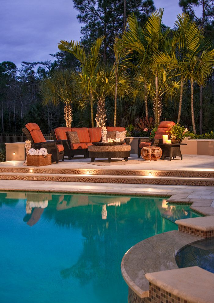 Lowes Naples Fl   Mediterranean Patio  and Hot Tub Low Wall Mosaic Tile Stair Risers Orange Cushions Outdoor Furniture Outdoor Lighting Palm Trees Patio Round Ottoman Stair Lighting Striped Chair Cushions
