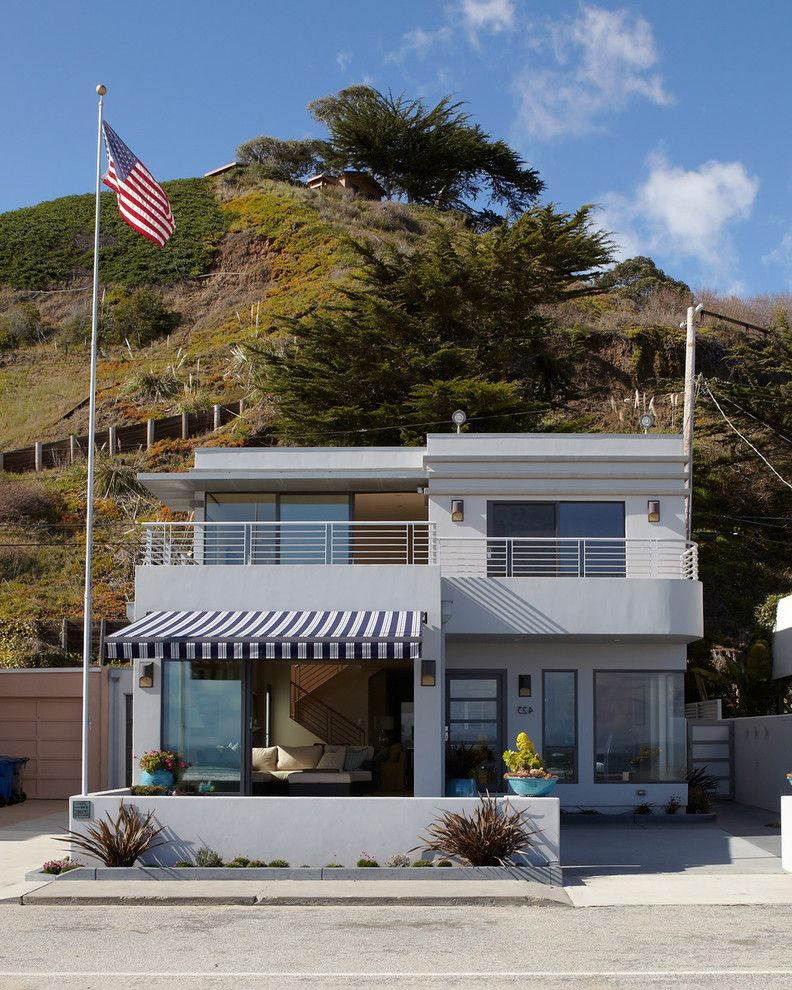 Lowes Oxnard   Beach Style Exterior Also 1920s Beach House Awning Balcony Corner Window Flagpole Gray Exterior Grey Exterior Landscaping Low Garden Wall Metal Railing Spiky Plants Striped Awning Stripes Vintage