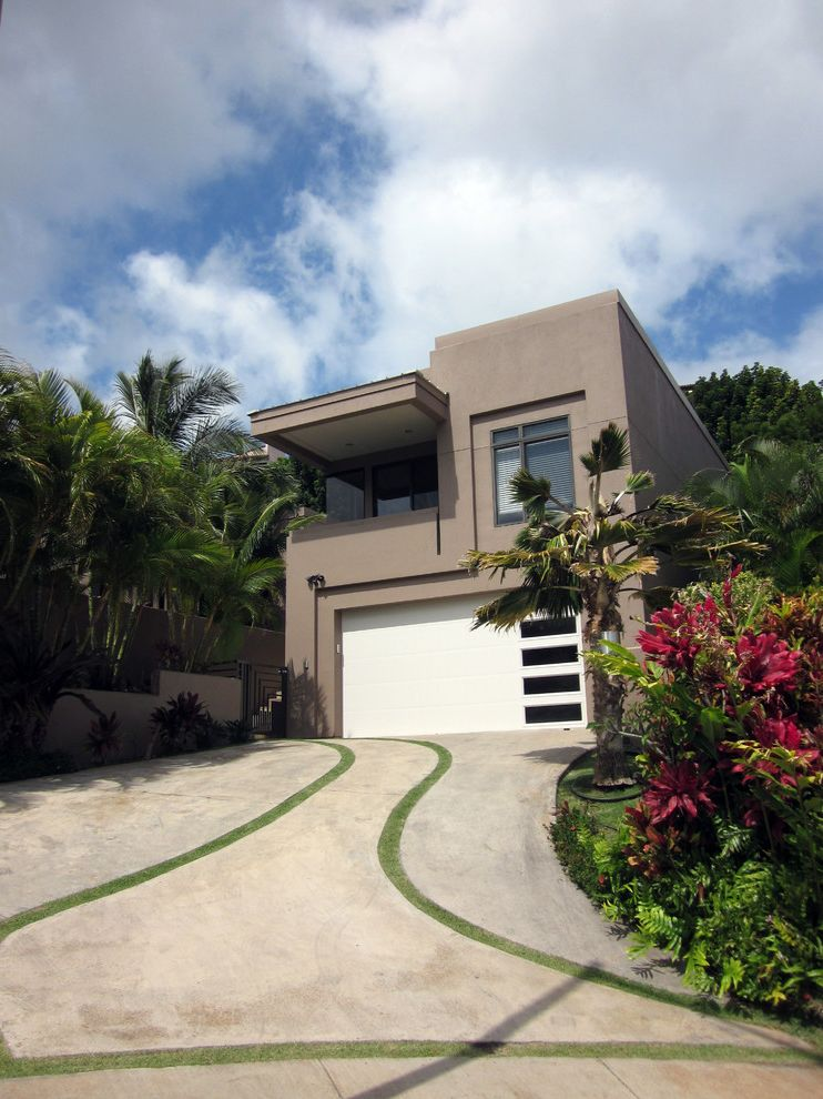 Lowes Oxnard with Tropical Exterior  and Boxy Cantilever Concrete Driveway Cool Driveway Grass in Cracks Gray House Hawaii Palm Tree Porch Overhang Tropical Landscape Tropical Plants White Garage Door