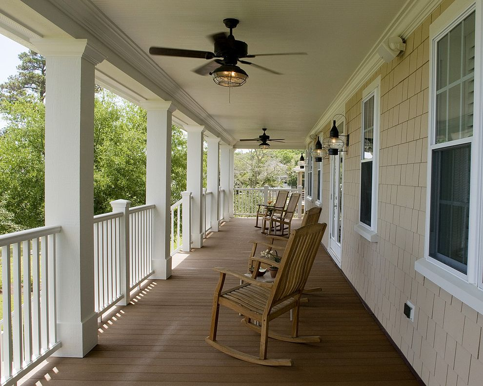 Lowes Pedestal Fan with Traditional Porch  and Ceiling Fan Deck Handrail Lanterns Outdoor Lighting Patio Furniture Rocking Chairs Shingle Siding White Wood Wood Columns Wood Railing Wood Trim