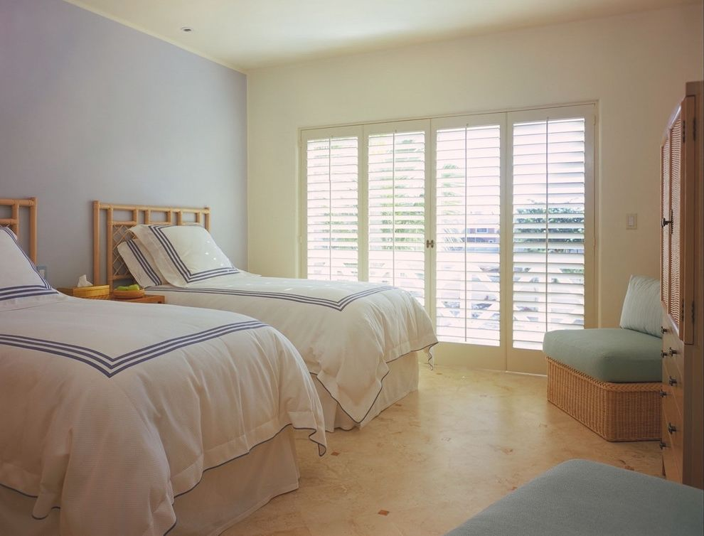 Lowes Plantation Shutters with Tropical Bedroom  and Accent Wall Armoire Bamboo Headboard Blue Wall Floor Tile Design Hotel Bedding Plantation Shutters Twin Beds White Bedding Wicker Furniture Wood Shutters
