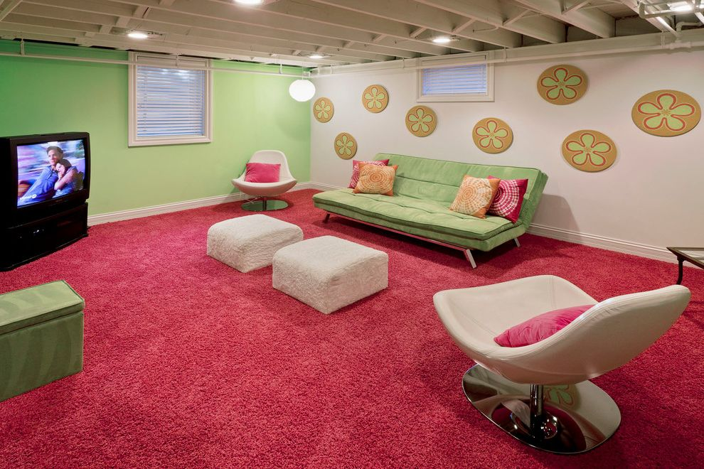 Lowes Pueblo Co with Midcentury Basement  and Accent Wall Baseboards Furry Pouf Green Sofa Green Walls Pink Carpet Tie Dye Pillows White Armchair