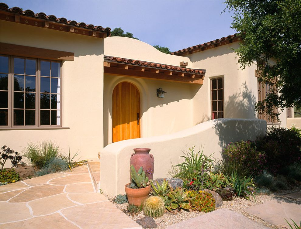 Lowes Santa Fe with Southwestern Exterior Also Arched Doorway Cactus Covered Entry Entry Flagstone Path Front Door Landscaping Lantern Planting Beds Spiky Plants Stucco Tile Roof Wood Trim