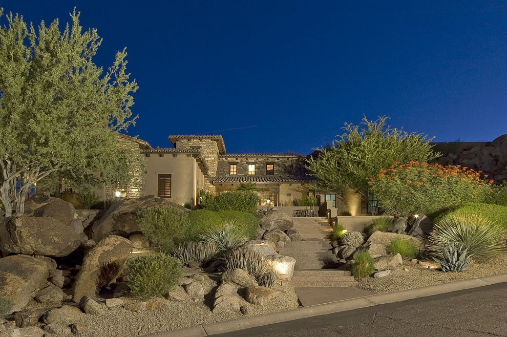 Lowes Santa Fe with Southwestern Exterior Also Boulder Desert Drought Tolerant Entrance Entry Gravel Hillside Low Maintenance Low Water Outdoor Lighting Path Planter Planting Rock Slope Terrace Tile Roof Walkway