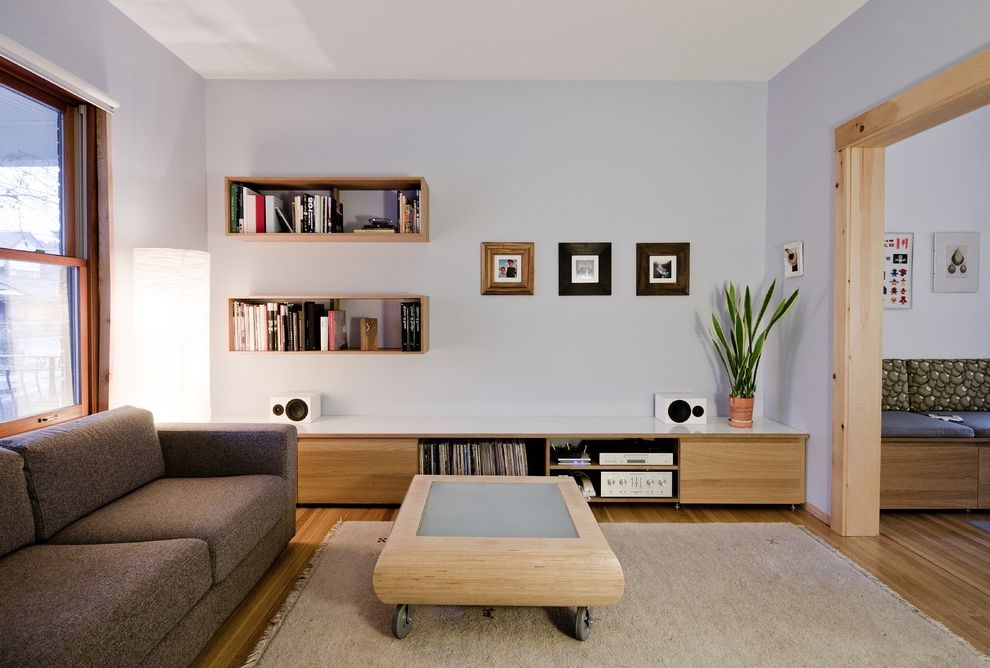 Lowes Shelving Units with Modern Living Room Also Area Rug Banquette Seating Brown Sofa Coffee Table on Casters Floating Bookshelves Floor Lamp Gray Walls Knotty Lumber Music Speakers Wood Floor Wood Trim