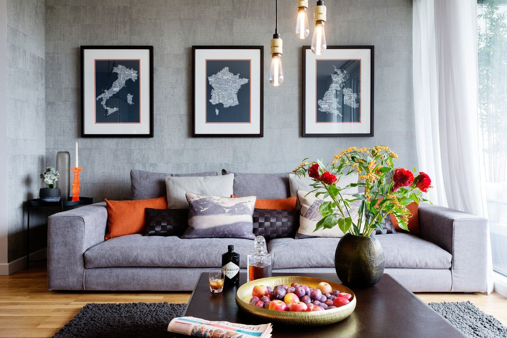 Lowes Traverse City with Contemporary Living Room  and Coffee Table Gray Rug Grey Sofa Hanging Lightbulbs Industrial Chic Lighting Orange Candleholder Sofa Textured Walls Wall Art Wood Flooring