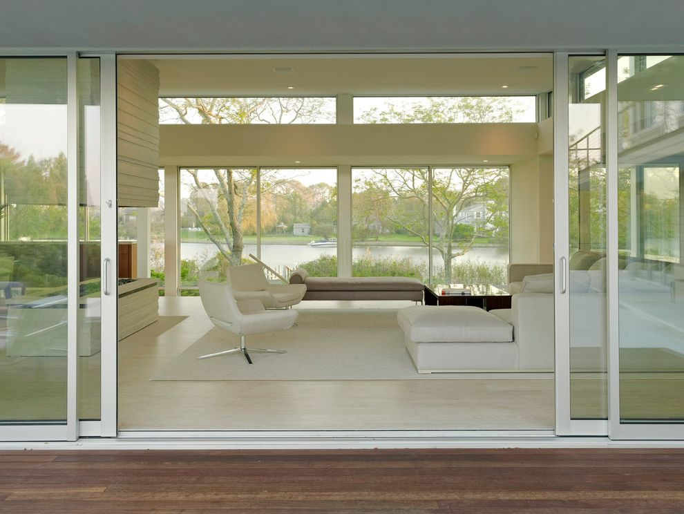 Lowes Warwick Ri with Contemporary Living Room  and Clerestory Window Coastal Contemporary Daybed Glass Wall Hearth Modern Open Fireplace Sectional Sofa Sustainable Swivel Chair White Rug White Sofa