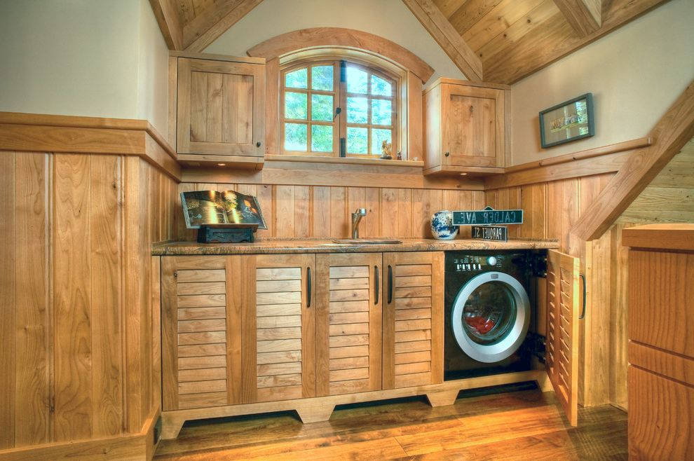 Lowes Wentzville Mo   Traditional Laundry Room  and Alder Arched Window Black Appliances Black Dryer Hidden Laundry Laundry Sink Louver Door Louvered Cabinets Vaulted Ceiling Wainscoting Washer Wood Cabinets