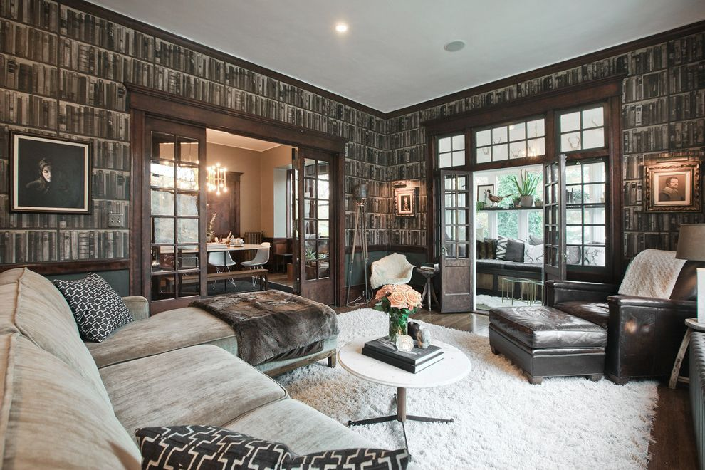 Lucys Furniture with Contemporary Living Room and Book Wallpaper Brown Armchair Brown Ottoman Dark Wood Crown Molding Dark Wood Trim French Doors Gray Sectional Sofa Neutral Palette Orange Roses Small Coffee Table White Coffee Table White Shag Rug
