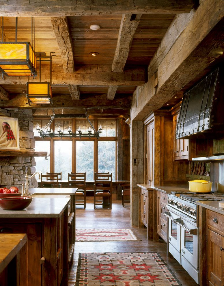 Lumber Liquidators Atlanta with Rustic Kitchen  and Cabin Kitchen Island Log Pendant Light Range Rustic Rustic Kitchen Cabinets Rustic Wood Cabinets Stone Wall Timber Wood Beam Wood Floor Wood Table