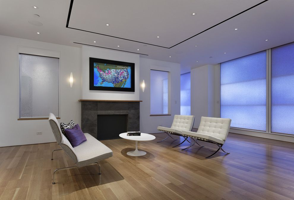 Lutron.com   Contemporary Family Room  and Family Room Hide Tv Media Decor Media Room Moving Art Tv Tv Over Fireplace White Lounge Chair White Sofa Wood Floors Media Decor