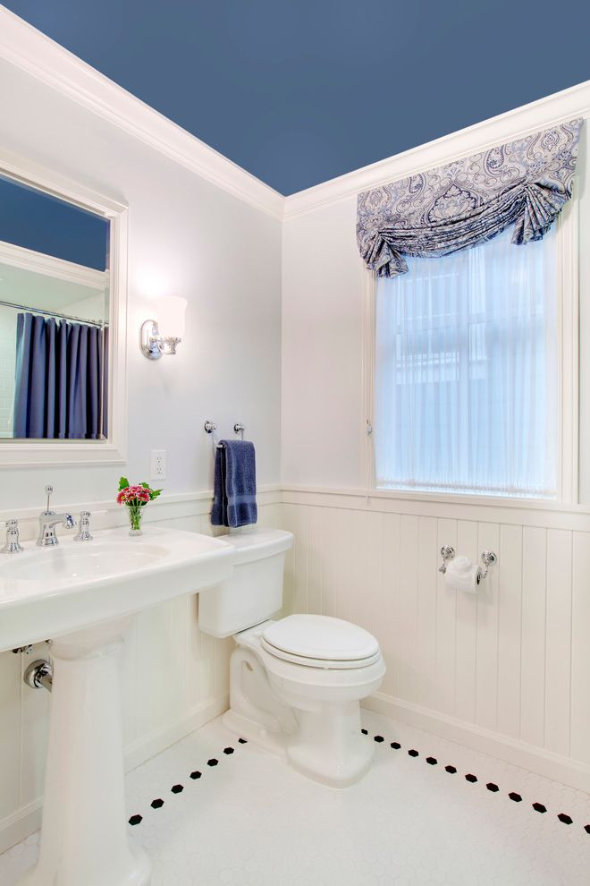 Madison Park Quilt Set   Traditional Bathroom  and Blue Ceiling Painted Ceiling Pedestal Sink Sheer Curtains Wall Sconce White Molding White Tile Floor White Trim White Wainscoting White Wall