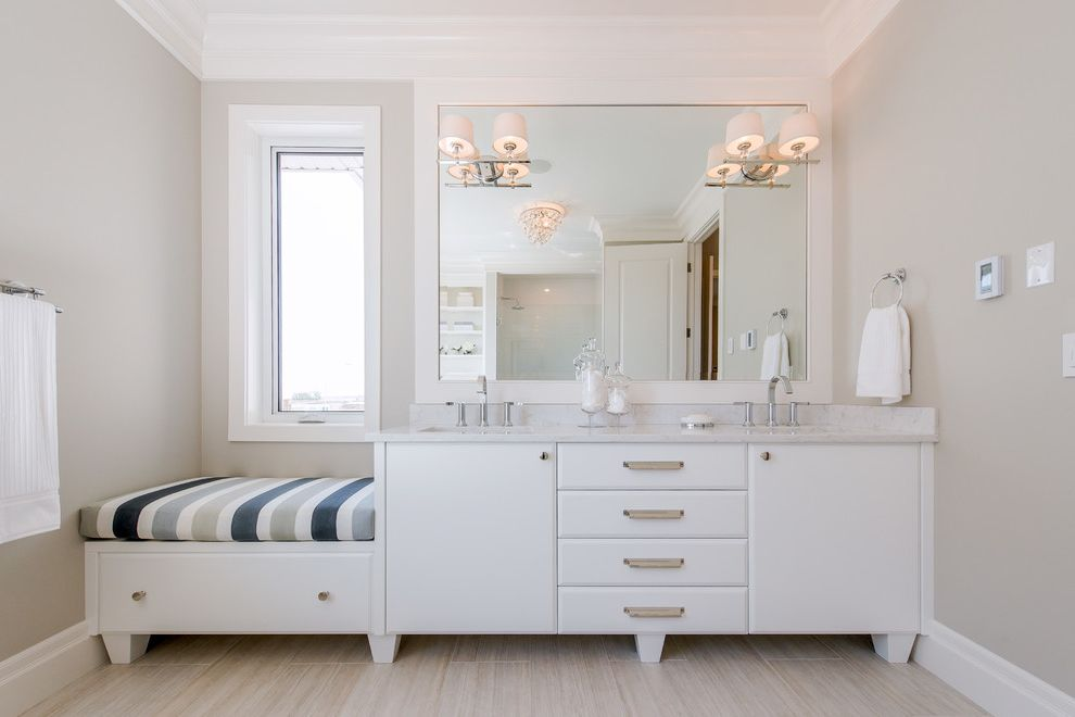 Madison Seating Review with Traditional Bathroom Also Gray Countertop Gray Walls Large Mirror Light Wood Floor Sconce Lighting Striped Cushion White Cabinets White Crown Molding