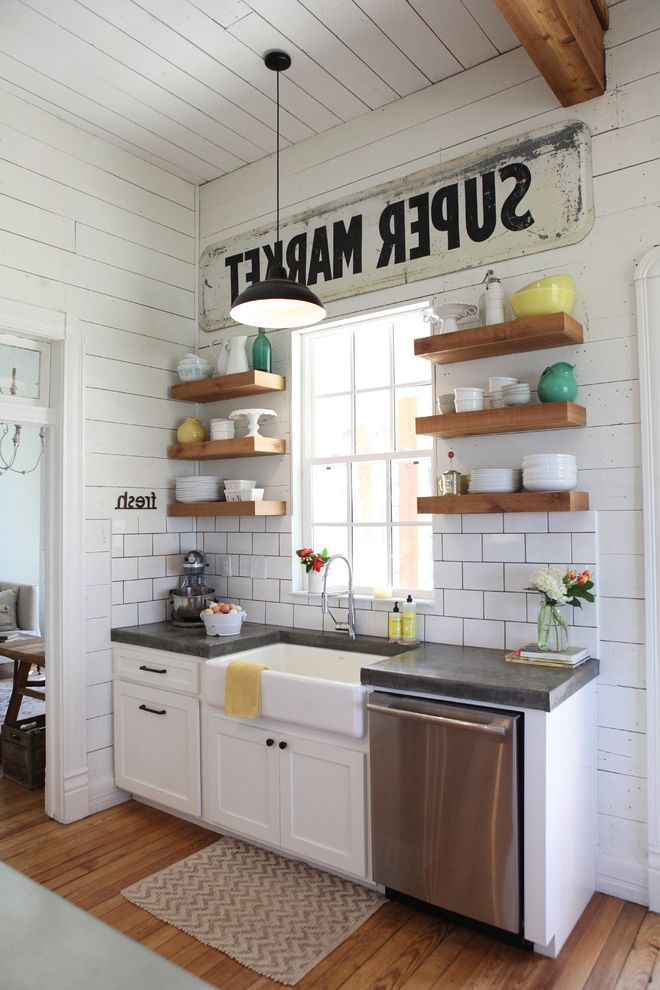 Magnolia Homes Waco   Farmhouse Kitchen  and Black Pendant Light Chevron Rug Floating Shelves Gray Countertop Open Shelves Vintage Sign Wood Ceiling Beam