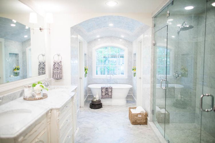 Magnolia Homes Waco   Traditional Spaces  and Barrell Ceiling Carerra Marble Tile Cast Iron Tub Double Vanity His and Her Shower