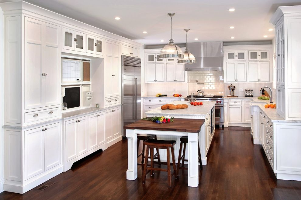 Manhattan Center for Kitchen and Bath   Traditional Kitchen Also Clerestory Cabinets Kitchen Organization Pendant Light Recessed Lighting White Countertop Wood Bar Stools Wood Countertop