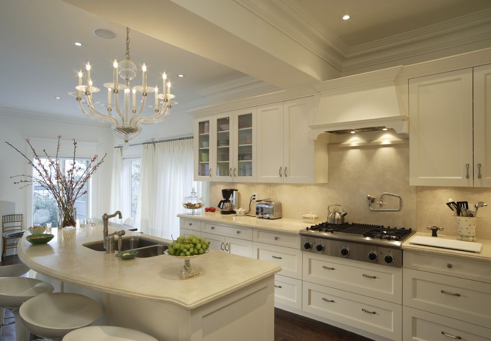 Manhattan Center for Kitchen and Bath   Traditional Kitchen  and Barstools Beam Breakfast Bar Chandelier Eat in Kitchen Glass Front Cabinets Molding Pot Filler Range Undermount Sink White Cabinets White Counters
