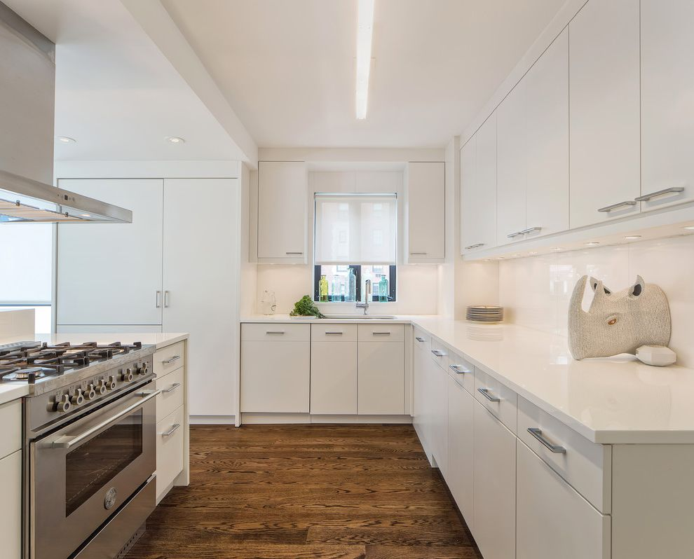 Manhattan Laminates with Contemporary Kitchen  and Contemporary Eclectic Gas Ranges Modern Recessed Lights Rhino Head Single Lever Faucet Under Cabinet Lighting White Countertop White Kitchen White Roller Shade Window Above Sink Wire Pulls