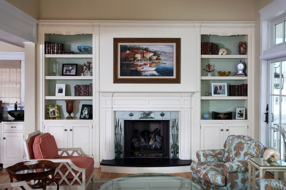 Marini Homes with Beach Style Living Room Also Accent Color Beach House Bookcase Built in Bookcase Fabric Painted Bookshelves Tiled Fireplace Wood Floor