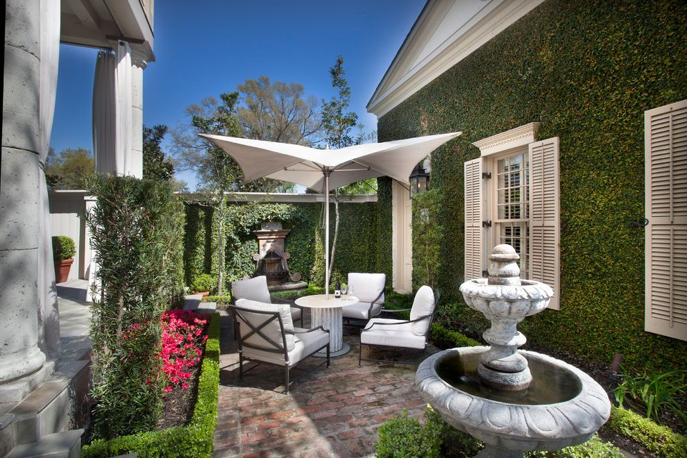 Market Umbrella Clearance with Traditional Patio Also Courtyard French Quarter Hedges Living Wall Outdoor Dining Shutters Umbrella Water Fountain Windows