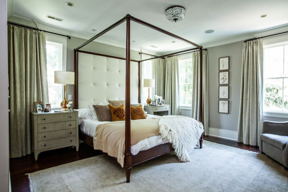 Masculine Bed Frames with Contemporary Bedroom Also Beige Bedding Dark Brown Bed Dark Wood Floor Four Poster Bed Mismatched Nightstands Orange Throw Pillow Tall Headboard Tall Table Lamp Tufted Headboard White Bedding White Headboard White Throw