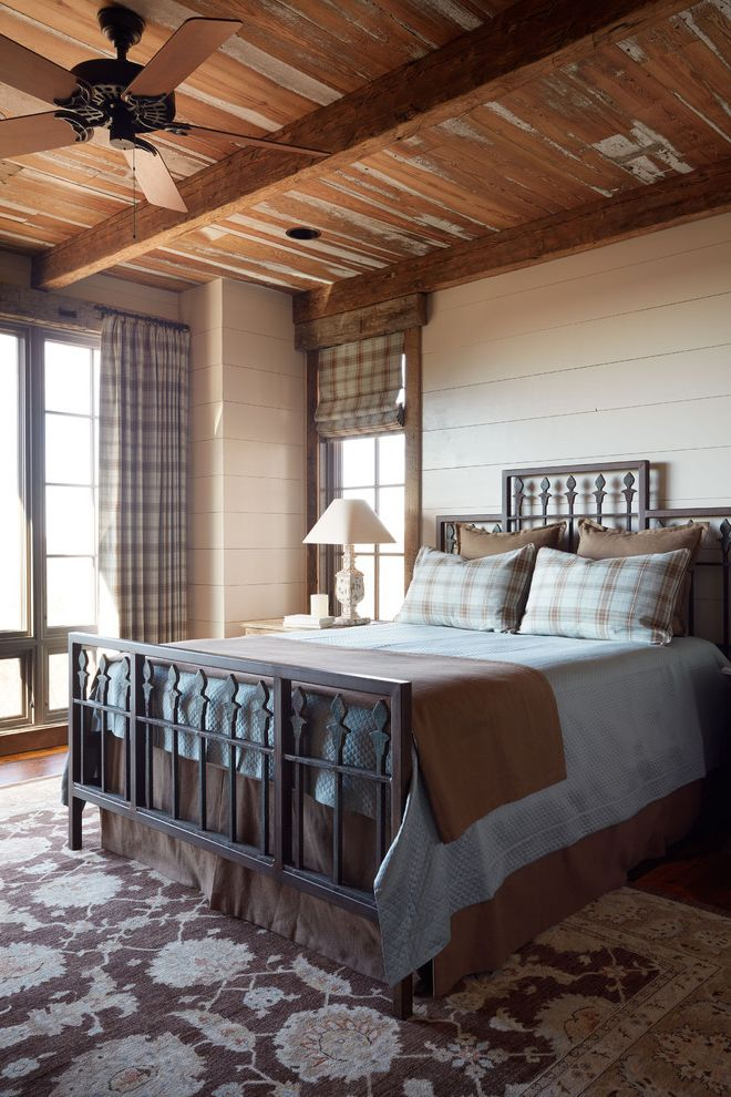 Masculine Bed Frames with Eclectic Bedroom Also Beams Blue Brown Floral Rug Iron Bed Large Windows Mountain Home Nightstand Plaid Bedding Plaid Drapes Plaid Roman Shade Reclaimed Ceiling Reclaimed Wood Rustic Ceiling Table Lamp