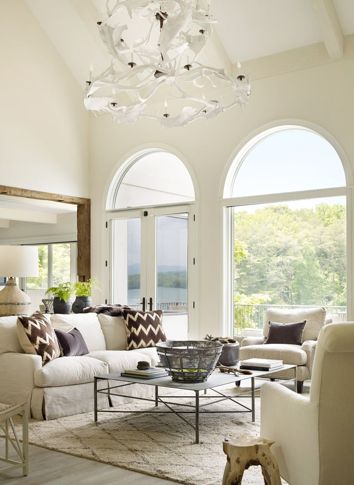 Mathews Furniture Atlanta   Transitional Living Room  and Antler Chandelier Arched Windows Exposed Beams Glass Doors Natural Light Pitched Roof Tall Windows White Antlers