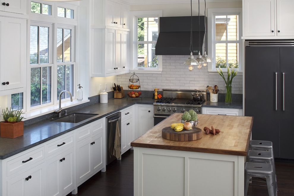 Matte Appliances with Rustic Kitchen Also Breakfast Bar Butcher Block Countertops Dark Floor Double Hung Windows Eat in Kitchen Fruit Basket Island Lighting Kitchen Island Pendant Lighting Range Hood Rustic White Cabinets White Kitchen Wood Cabinets