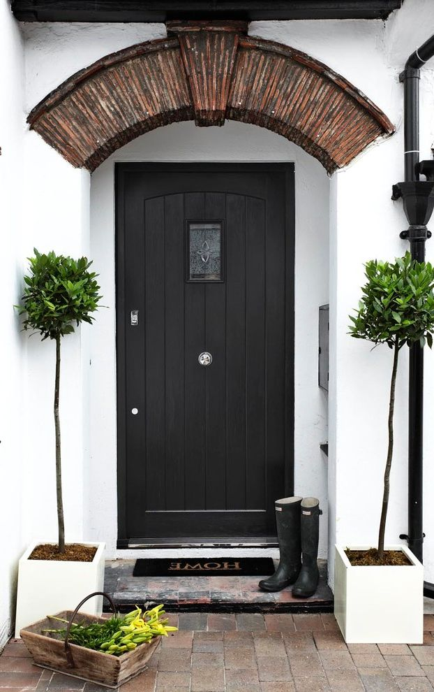 Matte Black Door Handles   Contemporary Entry  and Archway Black Door Covered Entry Front Door Pavers Step Topiary Welcome Mat White Stucco