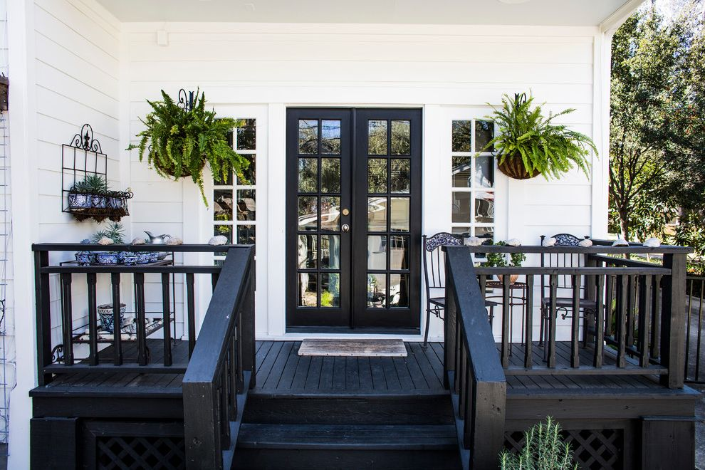 Matte Black Door Handles with Traditional Porch  and Black Black Porch Black Trim Chairs Fitstar French Doors Hanging Ferns Iron Outdoor Furniture Patio Chairs Plants Porch Seashells Sitting Area White White Panel Wood
