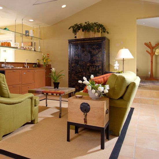 Mckelvey Homes    Living Room  and Bar Area Green Sofa Indoor Plants Neutral Colors